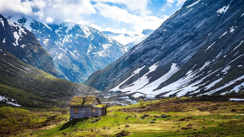 Cabin surrounded by mountains